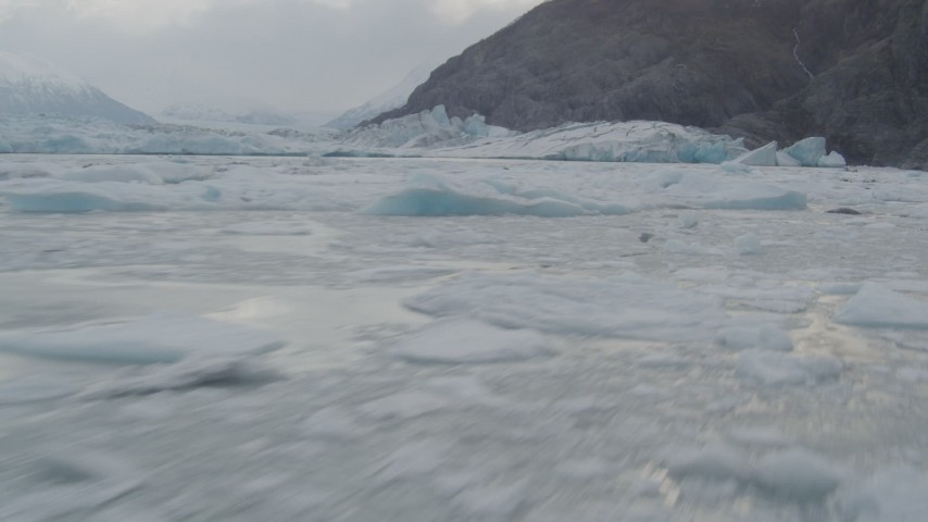 4K stock footage aerial video flying low over the icy Knik River, approaching Knik Glacier, Alaska Aerial Stock Footage | AK0001_0115