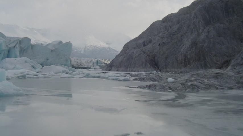 4K aerial video flying low over icy Knik River, tilt up, revealing Knik Glacier, Alaska Aerial Stock Footage   AK0001_0116