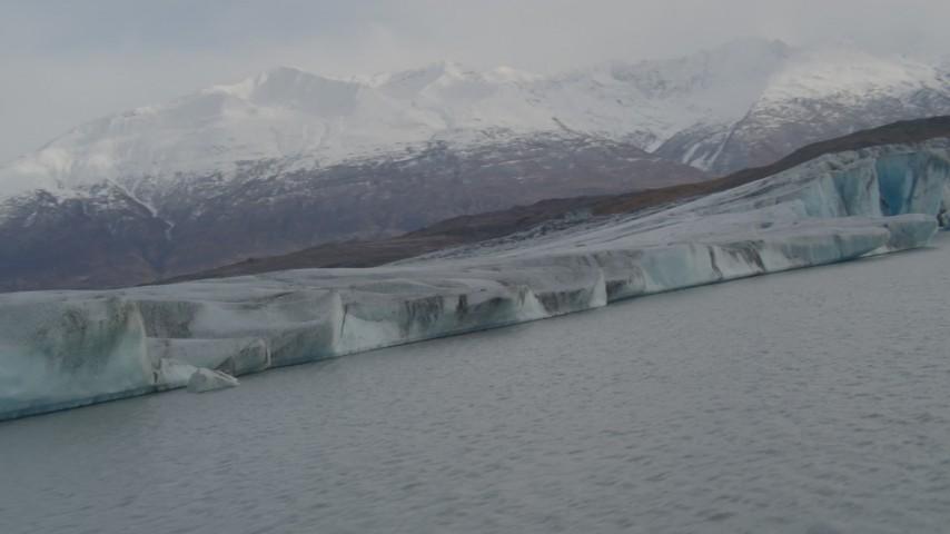 4K stock footage aerial video flying low over Knik River, pan left revealing Knik Glacier, Alaska Aerial Stock Footage | AK0001_0130