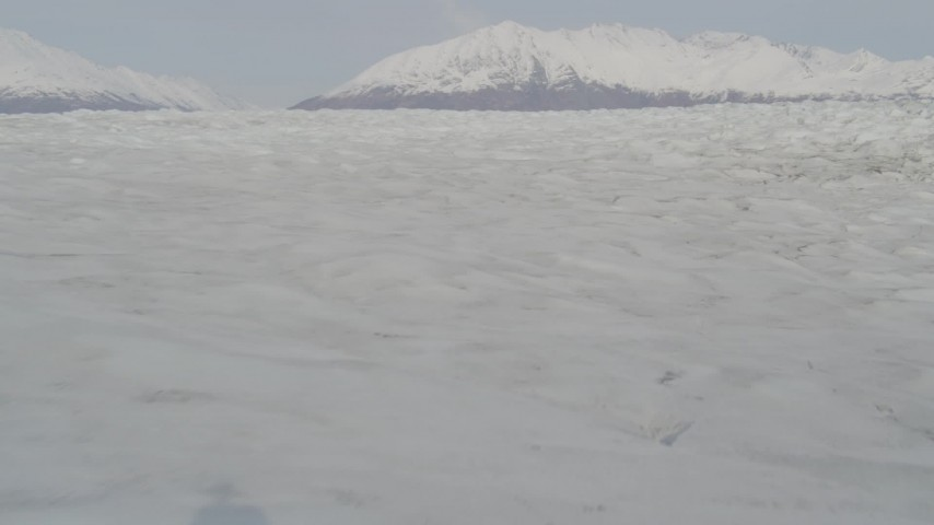 4K stock footage aerial video flying low over Knik Glacier, approaching Chugach Mountains, Knik Glacier, Alaska Aerial Stock Footage | AK0001_0132