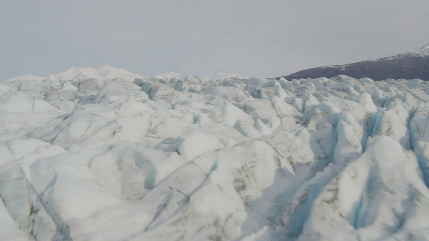 4K stock footage aerial video flying low over Knik Glacier, approach Chugach Mountains, Knik Glacier, Alaska Aerial Stock Footage   AK0001_0133