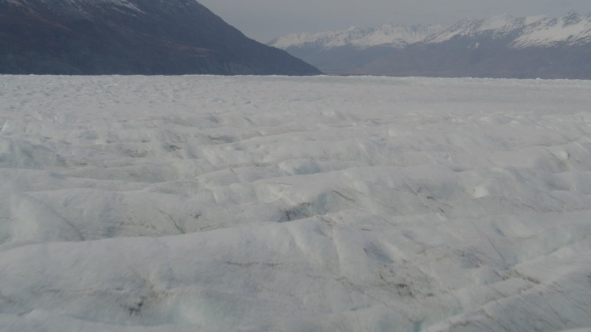 4K stock footage aerial video flying low over Knik Glacier, approaching Chugach Mountains, Knik Glacier, Alaska Aerial Stock Footage | AK0001_0135