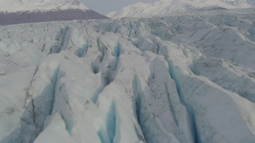 4K stock footage aerial video flying low over Knik Glacier, tilt down to surface of the glacier, Knik Glacier, Alaska Aerial Stock Footage | AK0001_0140