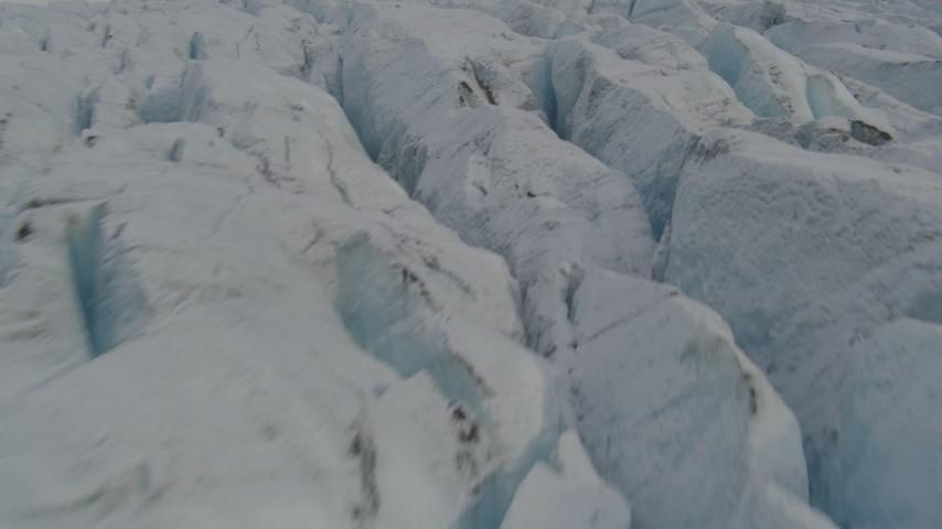 4K stock footage aerial video flying low over surface of Knik Glacier, tilt up, Knik Glacier, Alaska Aerial Stock Footage | AK0001_0141