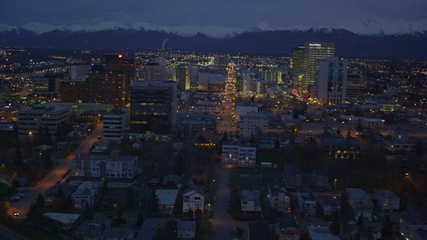 4K aerial video revealing Hotel Captain Cook, Downtown Anchorage, Alaska, night Aerial Stock Footage | AK0001_0156