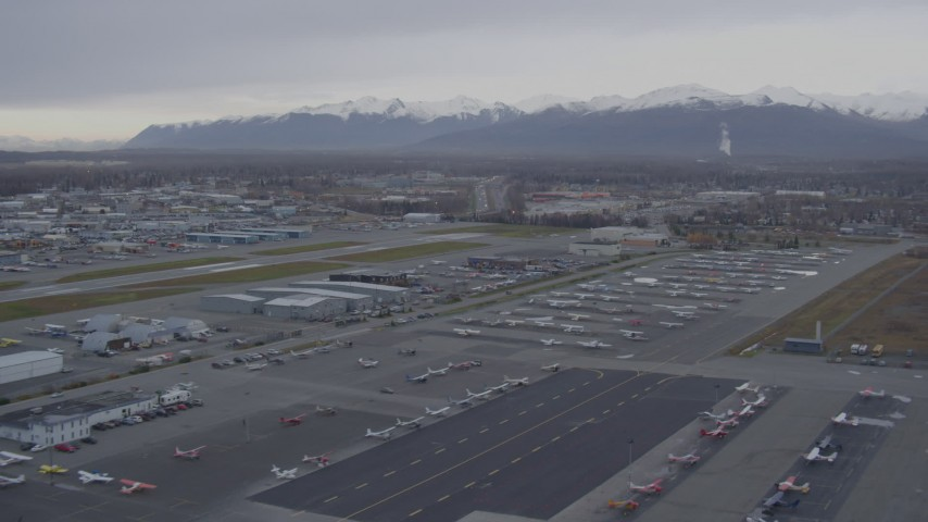 4K stock footage aerial video flying low over Merrill Field runways, parked planes, Anchorage, Alaska Aerial Stock Footage | AK0001_0157