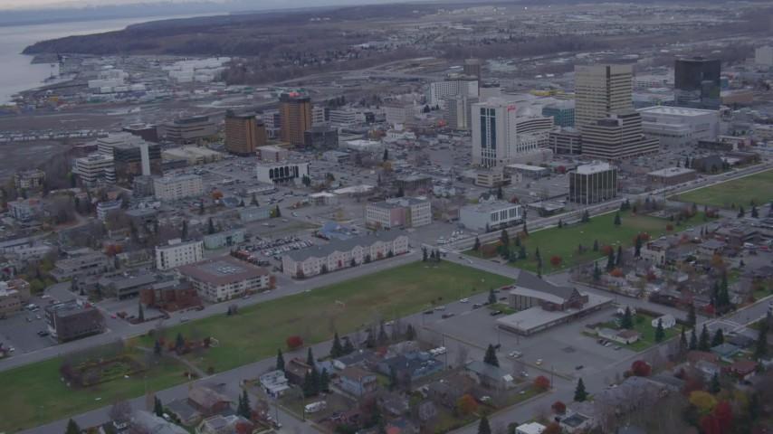 4K stock footage aerial video tilt up from neighborhood, revealing downtown buildings, Anchorage, Alaska Aerial Stock Footage   AK0001_0161