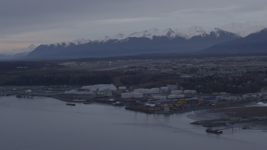 4K stock footage aerial video flying by an oil refinery on the shore of Knik Arm of Cook Inlet, Anchorage, Alaska Aerial Stock Footage | AK0001_0164