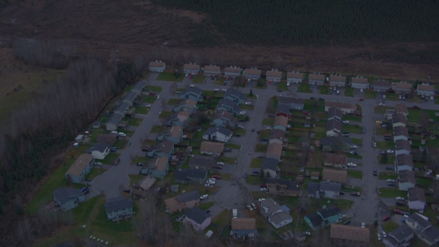 4K stock footage aerial video flying over residential neighborhood, reveal countryside, Anchorage, Alaska Aerial Stock Footage | AK0001_0179