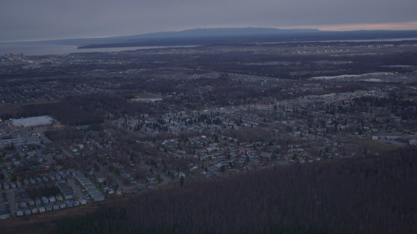 4K stock footage aerial video flying away from Anchorage, Knik Arm of the Cook Inlet, Anchorage, Alaska, twilight Aerial Stock Footage | AK0001_0180