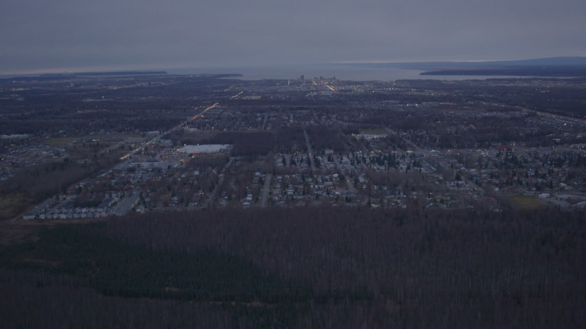 4K stock footage aerial video approaching Downtown and Anchorage, Alaska, twilight Aerial Stock Footage | AK0001_0181