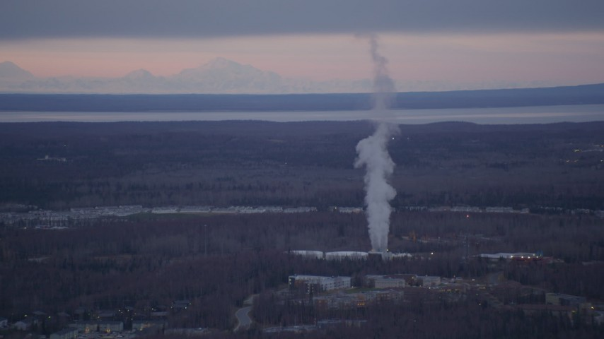 4K stock footage aerial video flying by a power plant, Anchorage, Alaska, twilight Aerial Stock Footage | AK0001_0184
