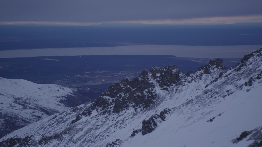 4K aerial video snowy summit, Knik Arm of the Cook Inlet, Chugach Mountains, Alaska, twilight Aerial Stock Footage | AK0001_0189