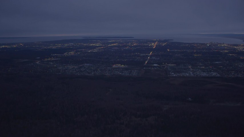 4K stock footage aerial video flying by Anchorage, revealing Downtown Anchorage, Alaska, night Aerial Stock Footage | AK0001_0192