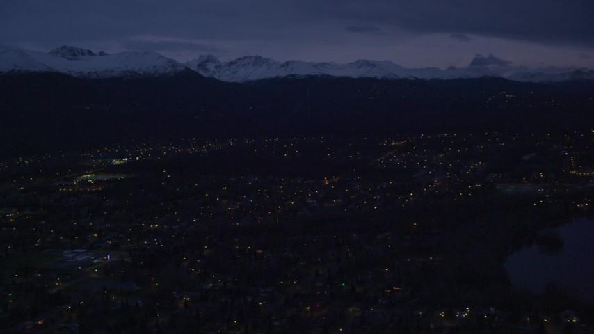 4K stock footage aerial video flying by suburban neighborhood, pan left, Anchorage, Alaska, night Aerial Stock Footage | AK0001_0194