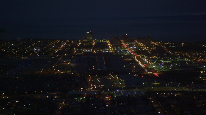 4K stock footage aerial video approaching Merrill Field and Downtown Anchorage, Alaska, night Aerial Stock Footage | AK0001_0196