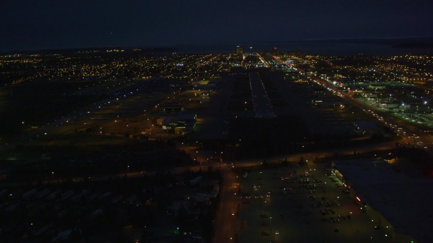 4K stock footage aerial video approaching Merrill Field, landing aircraft, Anchorage, Alaska, night Aerial Stock Footage | AK0001_0197
