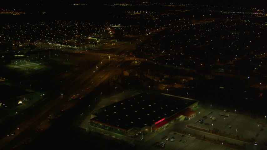 4K stock footage aerial video tilt up from intersection, following freeway and revealing Anchorage, Alaska, night Aerial Stock Footage | AK0001_0198
