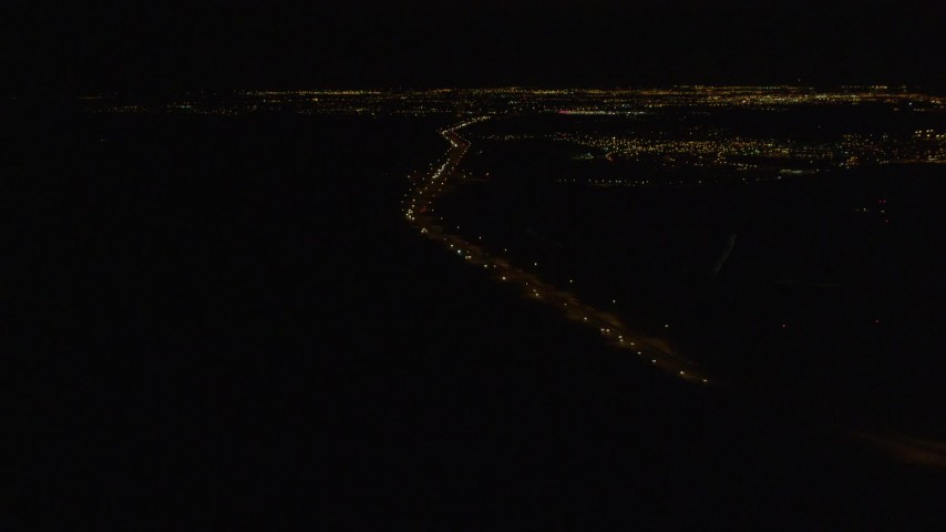 4K stock footage aerial video following Glenn Highway, winding toward Anchorage, Alaska, night Aerial Stock Footage | AK0001_0204
