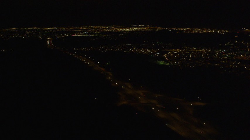4K stock footage aerial video following Glenn Highway, tilt up to Anchorage, Alaska, night Aerial Stock Footage | AK0001_0205