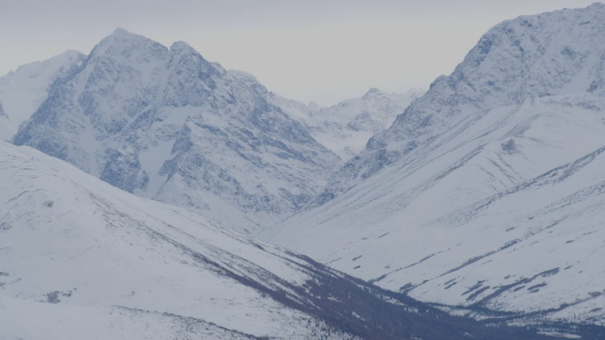 4K aerial video flying by snow covered peaks, Chugach Mountains, Alaska Aerial Stock Footage | AK0001_0232