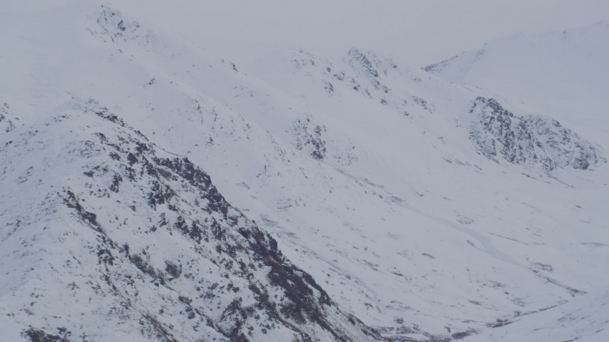 4K stock footage aerial video flyby by snow covered peaks, Chugach Mountains, Alaska Aerial Stock Footage | AK0001_0234