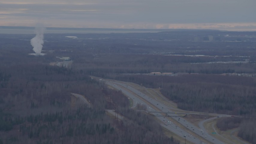 4K stock footage aerial video pan right by Glenn Highway, plower plant, Anchorage, Alaska Aerial Stock Footage | AK0001_0239