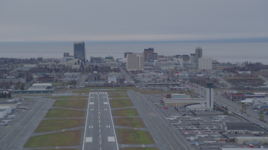 4K stock footage aerial video approaching Merrill Field, quick zoom to Downtown buildings, Anchorage, Alaska Aerial Stock Footage | AK0001_0245