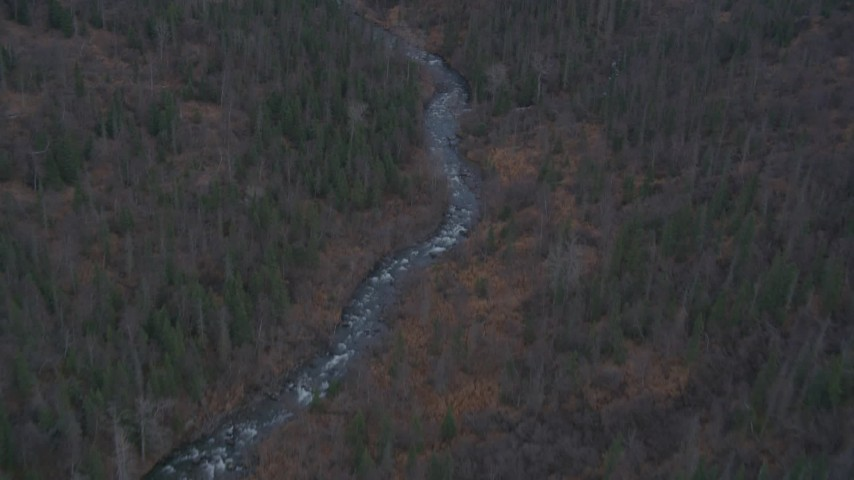 4K aerial video river through forested foothills, Chugach Mountains, Fort Richardson, Anchorage Aerial Stock Footage | AK0001_0250