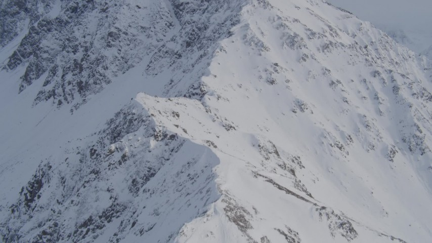 4K stock footage aerial video ascending snow covered slope, Chugach Mountains, Alaska Aerial Stock Footage | AK0001_0259