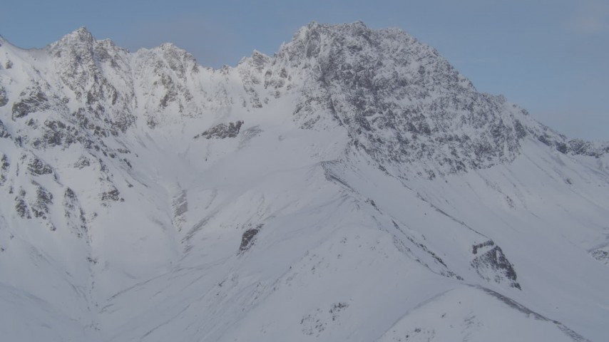 4K stock footage aerial video flying by snowy mountain peaks, Chugach Mountains, Alaska Aerial Stock Footage | AK0001_0262