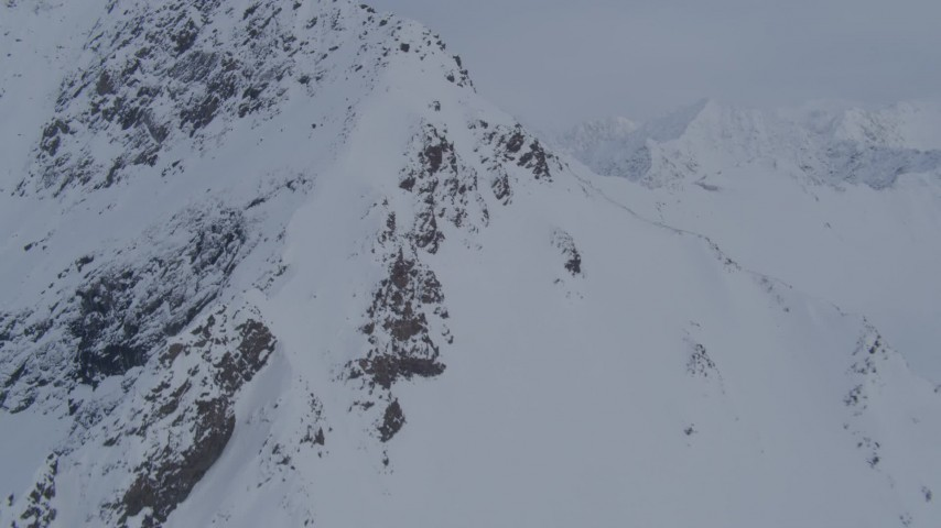 4K stock footage aerial video approaching snowy peak, valley, Chugach Mountains, Alaska Aerial Stock Footage   AK0001_0264