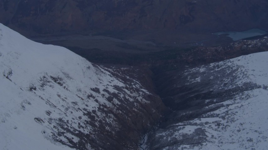 4K stock footage aerial video following river, revealing deep valley, Chugach Mountains, Alaska Aerial Stock Footage | AK0001_0266