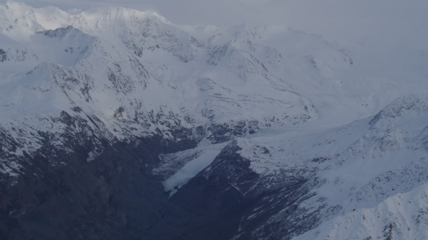 4K stock footage aerial video flying over deep valley, approaching a glacier, Chugach Mountains, Alaska Aerial Stock Footage | AK0001_0267