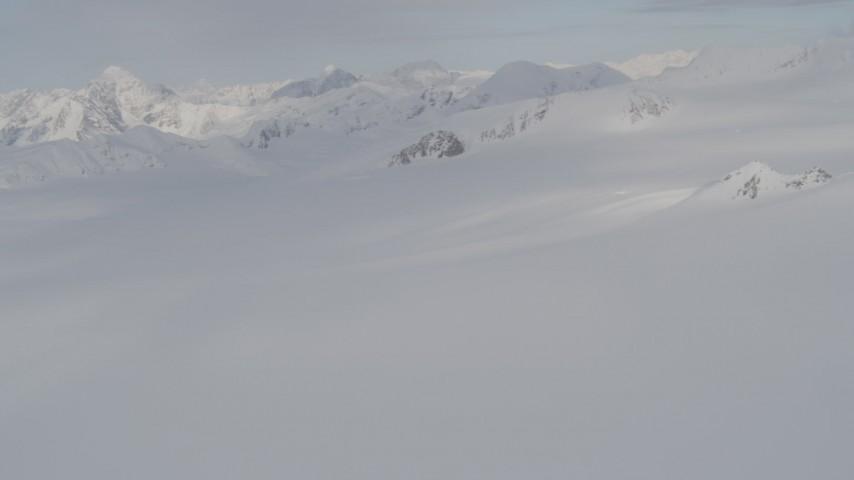 4K aerial video pan left across snow covered valley, peaks, Chugach Mountains, Alaska Aerial Stock Footage   AK0001_0273
