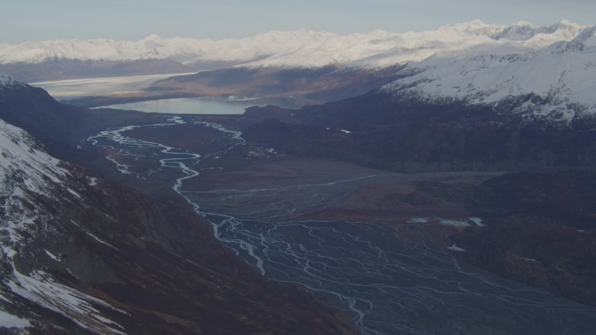 4K stock footage aerial video flying over a river valley, pan right to reveal a glacier, Inner Lake George, Alaska Aerial Stock Footage | AK0001_0279