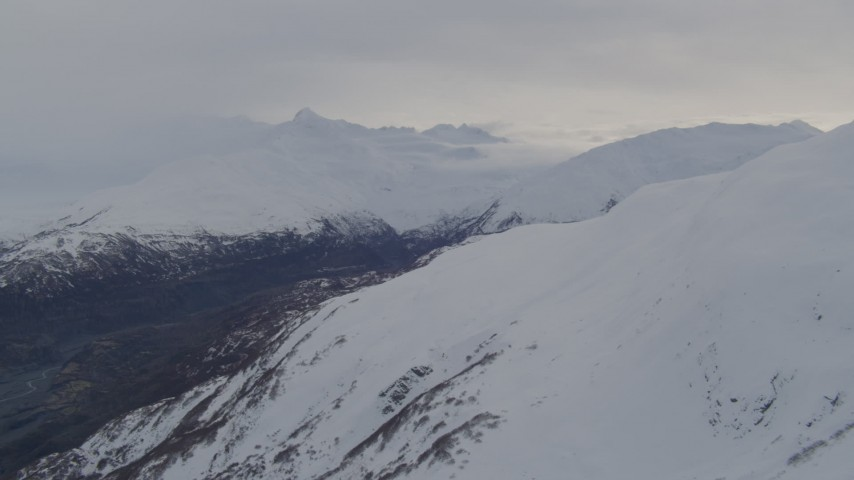4K stock footage aerial video snow capped peaks, approaching river valley, Chugach Mountains, Alaska Aerial Stock Footage | AK0001_0280