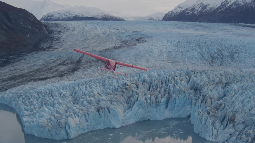 4K stock footage aerial video tracking seaplane over a glacier, lake, Inner Lake George, Alaska Aerial Stock Footage | AK0001_0284