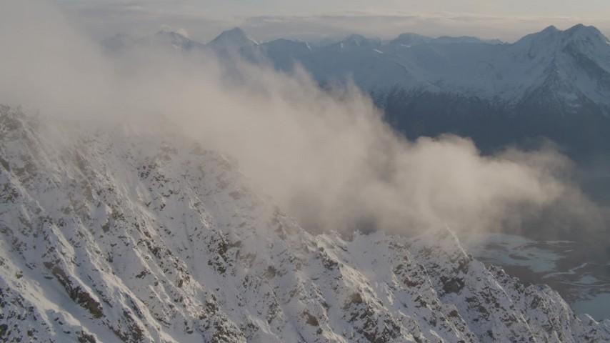 4K stock footage aerial video snowy slopes, clouds, Knik River Valley, Knik Glacier, Chugach Mountains, Alaska Aerial Stock Footage | AK0001_0296