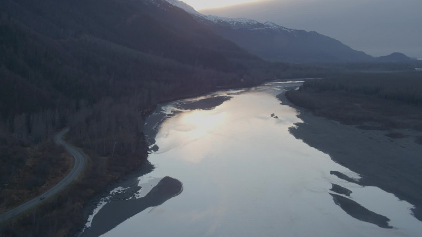 4K stock footage aerial video tilting up from the river, Knik River, Alaska, sunset Aerial Stock Footage | AK0001_0304