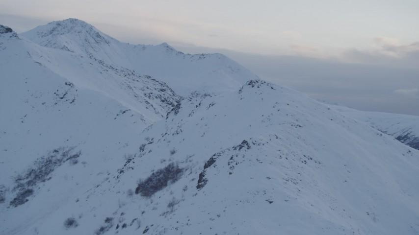 4K stock footage aerial video fly over snowy peak, approach second peak, Chugach Mountains, Alaska, twilight Aerial Stock Footage | AK0001_0323