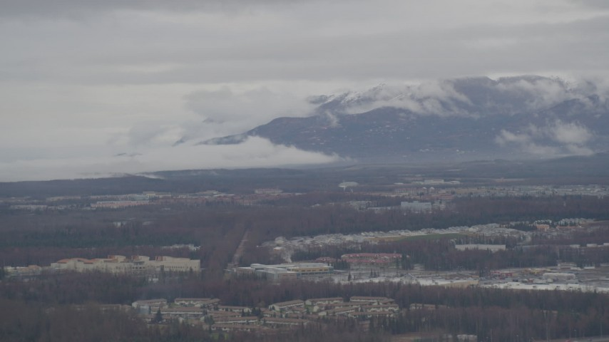 4K stock footage aerial video flying by neighborhoods, Chugach Mountains in the distance, Anchorage, Alaska Aerial Stock Footage | AK0001_0337