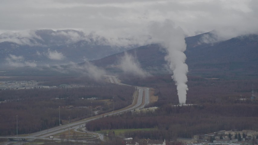 4K stock footage aerial video flying by a power plant near Glenn Highway, Anchorage, Alaska Aerial Stock Footage | AK0001_0338