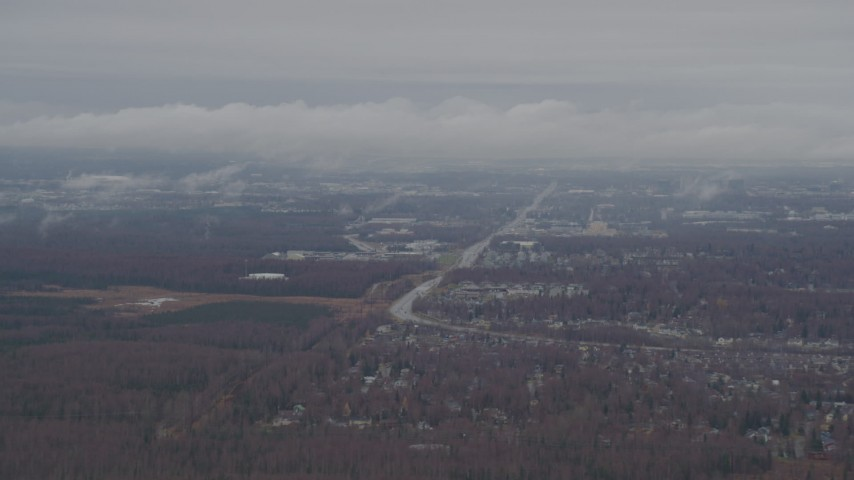 4K stock footage aerial video flying by Anchorage with low lying clouds, Anchorage, Alaska Aerial Stock Footage | AK0001_0341