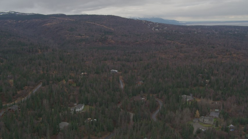 4K stock footage aerial video flying over forested foothills, approaching neighborhood, Anchorage, Alaska Aerial Stock Footage | AK0001_0342