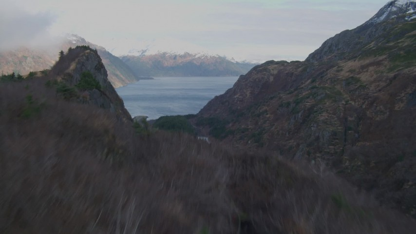 4K stock footage aerial video over hills and ridge, revealing Passage Canal, Whittier Airport, Whittier, Alaska Aerial Stock Footage | AK0001_0394