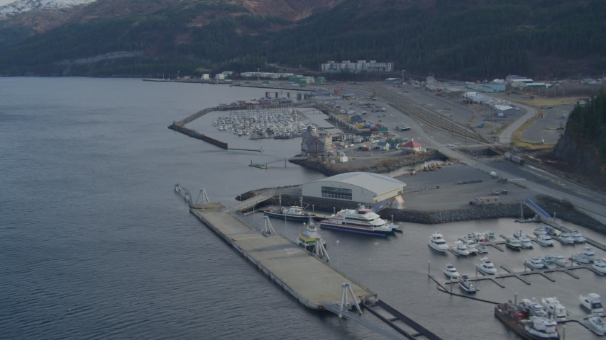 4K stock footage aerial video descending low over the bay, near the town, docks, Whittier, Alaska Aerial Stock Footage | AK0001_0396