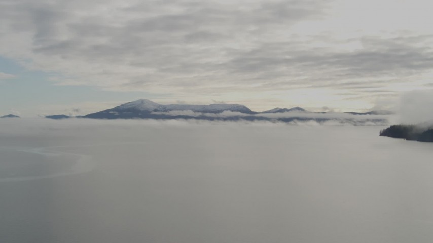 4K stock footage aerial video flying low over the bay covered in low clouds, Prince William Sound, Alaska Aerial Stock Footage | AK0001_0411