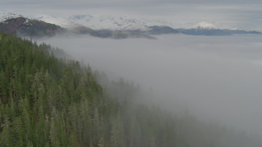 4K stock footage aerial video fog covered bay, approaching Chugach Mountains, Prince William Sound, Alaska Aerial Stock Footage | AK0001_0413