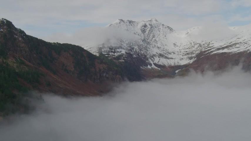 4K stock footage aerial video fly around rim of Chugach Mountain ridge, fog, Prince William Sound, Alaska Aerial Stock Footage | AK0001_0415
